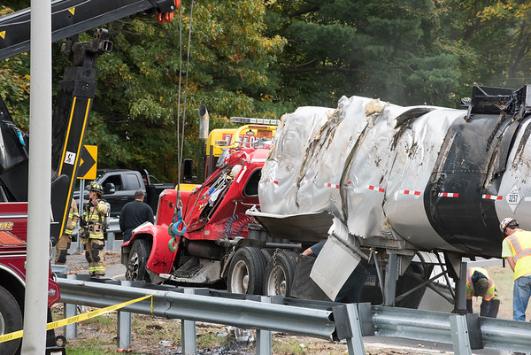 10/29/19 Wesley Bunnell | StaffrrA semi trailer carrying hot asphalt overturned on the Mill St exit in Berlin this morning causing asphalt to spill from the top of the tanker mostly onto a grassy divider.