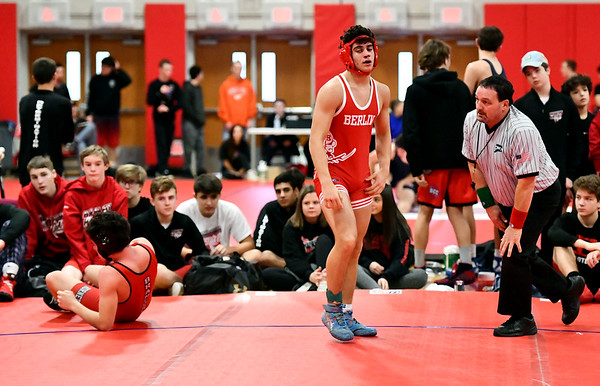 1/11/2020 Mike Orazzi | StaffrBerlin's Marco Marino and Branford's T.J. Shields while wrestling Saturday at Berlin High School.