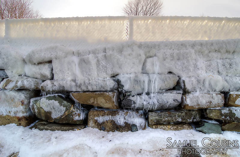 The ice-covered sea wall at the East End Beach after the blizzard of 2013