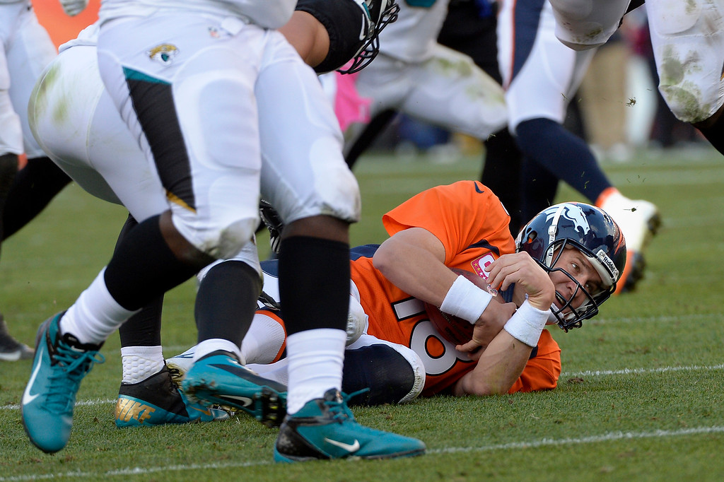 . DENVER, CO. - October 13: Denver Broncos quarterback Peyton Manning #18 slides in the 4th quarter vs the Jacksonville Jaguars at Sports Authority Field at Mile High. August 13, 2013 Denver, October. (Photo By Joe Amon/The Denver Post)