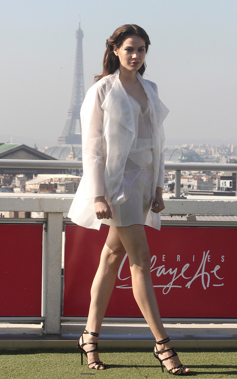 . A model presents a creation as part of French fashion designer Christine Phung\'s ready-to-wear Spring/Summer 2014 fashion collection presented in Paris, Tuesday, Sept.24, 2013. The Eiffel Tower is seen in background. (AP Photo/Thibault Camus)