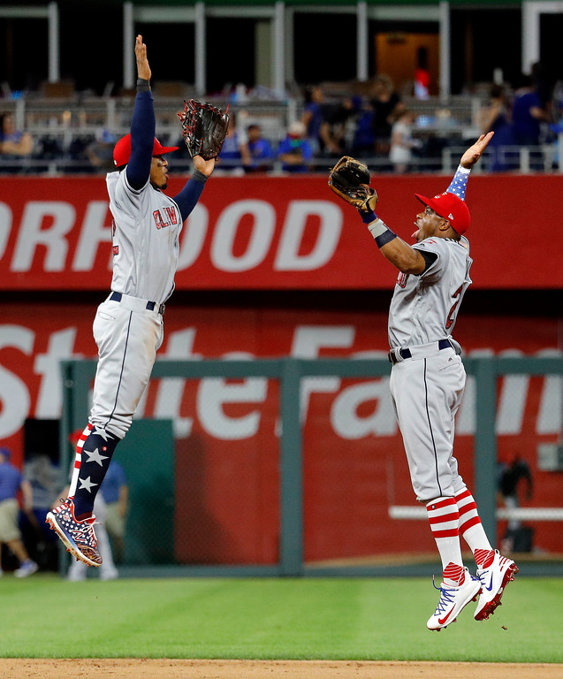 . Cleveland Indians\' Francisco Lindor, left, and Rajai Davis celebrate the team\'s 6-4 win in a baseball game against the Kansas City Royals on Tuesday, July 3, 2018, in Kansas City, Mo. (AP Photo/Charlie Riedel)