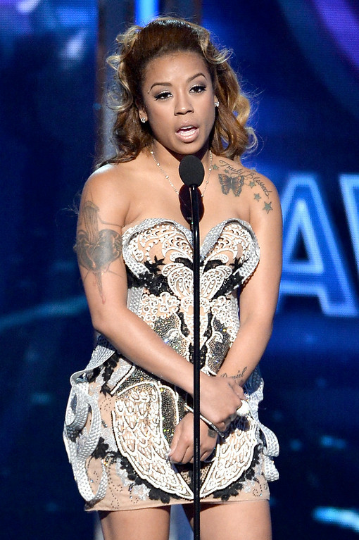 . Singer Keyshia Cole speaks onstage during the BET AWARDS \'14 at Nokia Theatre L.A. LIVE on June 29, 2014 in Los Angeles, California.  (Photo by Kevin Winter/Getty Images for BET)