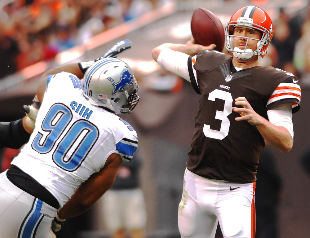 . Michael Allen Blair/MBlair@21st-CenturyMedia.com Browns\' quarterback Brandon Weeden throws an interception under pressure from Lions\' defensive tackle Ndamukong Suh during the second quarter versus the Lions at FirstEnergy Stadium in Cleveland, OH. on Sunday, October 13, 2013.