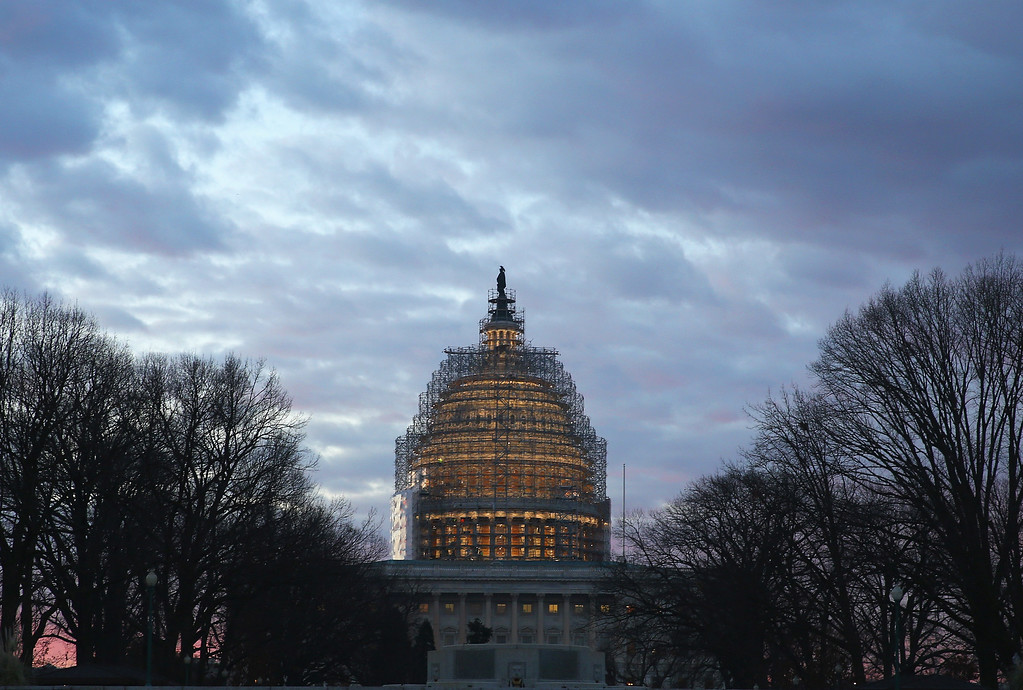 . WASHINGTON, DC - JANUARY 20:  The early morning sun begins to rise benhind the US Capitol building on January 20, 2015 in Washington, DC. Later this evening US President Barack Obama will deliver his sixth State Of The Union address to the nation.  (Photo by Mark Wilson/Getty Images)