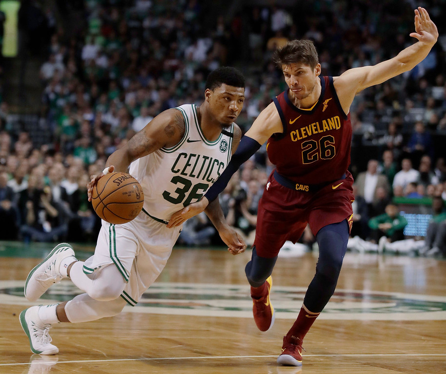 . Boston Celtics guard Marcus Smart, left, drives against Cleveland Cavaliers guard Kyle Korver during the second half in Game 2 of the NBA basketball Eastern Conference finals, Tuesday, May 15, 2018, in Boston. (AP Photo/Charles Krupa)