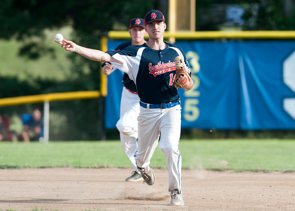 07/25/19 Wesley Bunnell | Staff Southington Legion baseball defeated RCP with a walk off double to advance in the playoffs. Jeremy Mercier (14) throws to first.