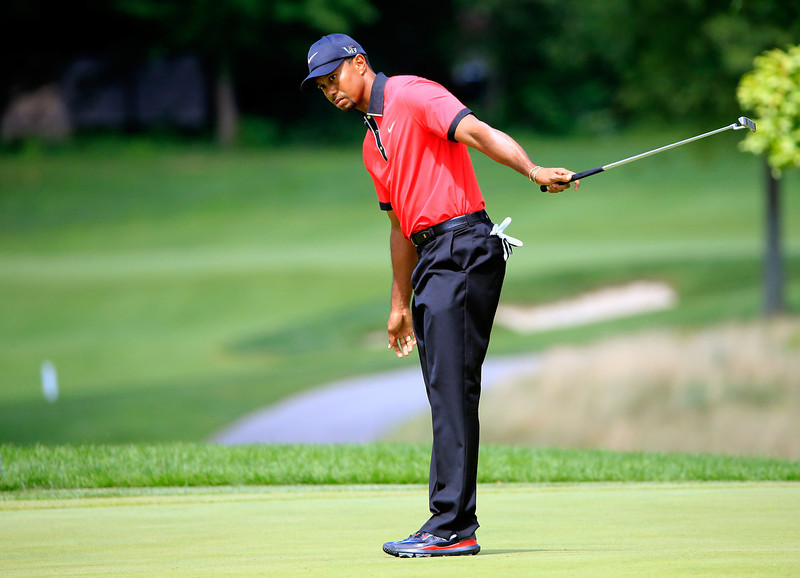 . Tiger Woods reacts to a putt on the fifth green during the Final Round of the World Golf Championships-Bridgestone Invitational at Firestone Country Club South Course on August 4, 2013 in Akron, Ohio.  (Photo by Sam Greenwood/Getty Images)