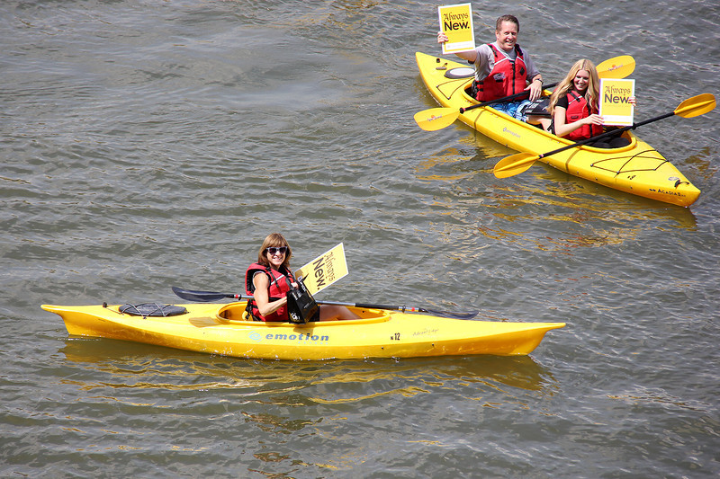 Assembly workers take a break to kayak on the Allegheny River.