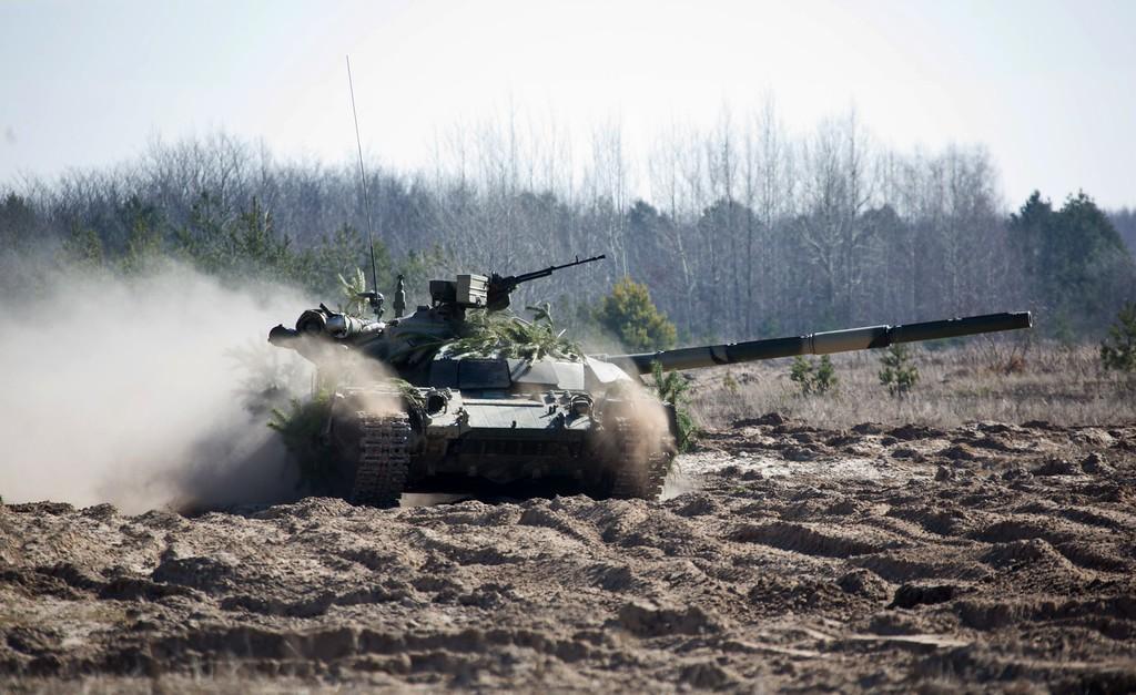 . In this photo taken Friday, March 14, 2014, a Ukrainian APC moves during military exercises of Ukrainian troops near Chernigiv, 150 km (94 miles) north of Kiev, Ukraine. (AP Photo/Mykhailo Markiv, Pool)