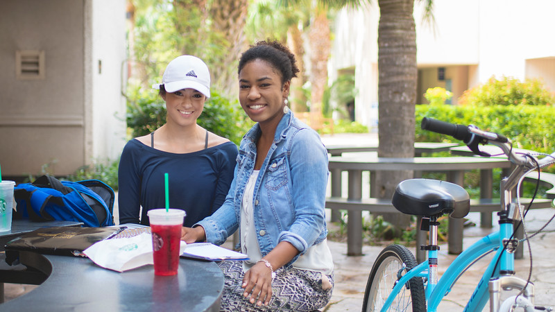 Allyson Sturgeon (left) and Kayla Stovall enjoy the setting on the Starbucks patio as they work on planning for the Rotaract Club.