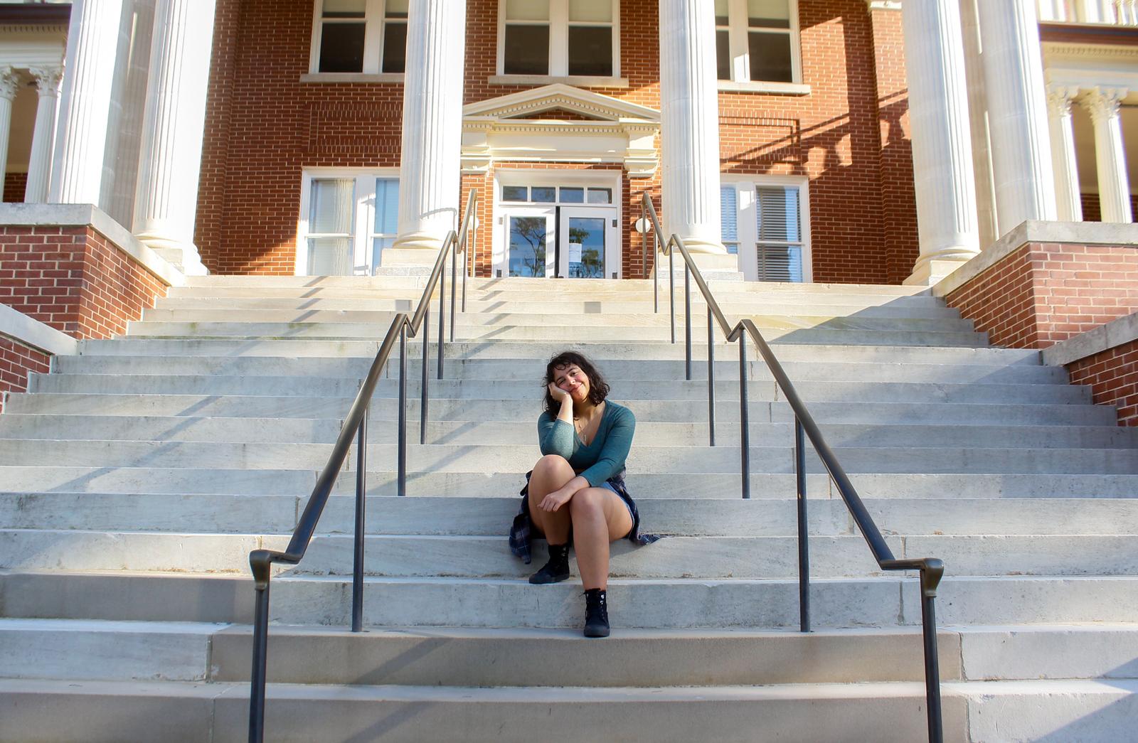 Raasha Gutierrez on the steps of Ennis Hall.