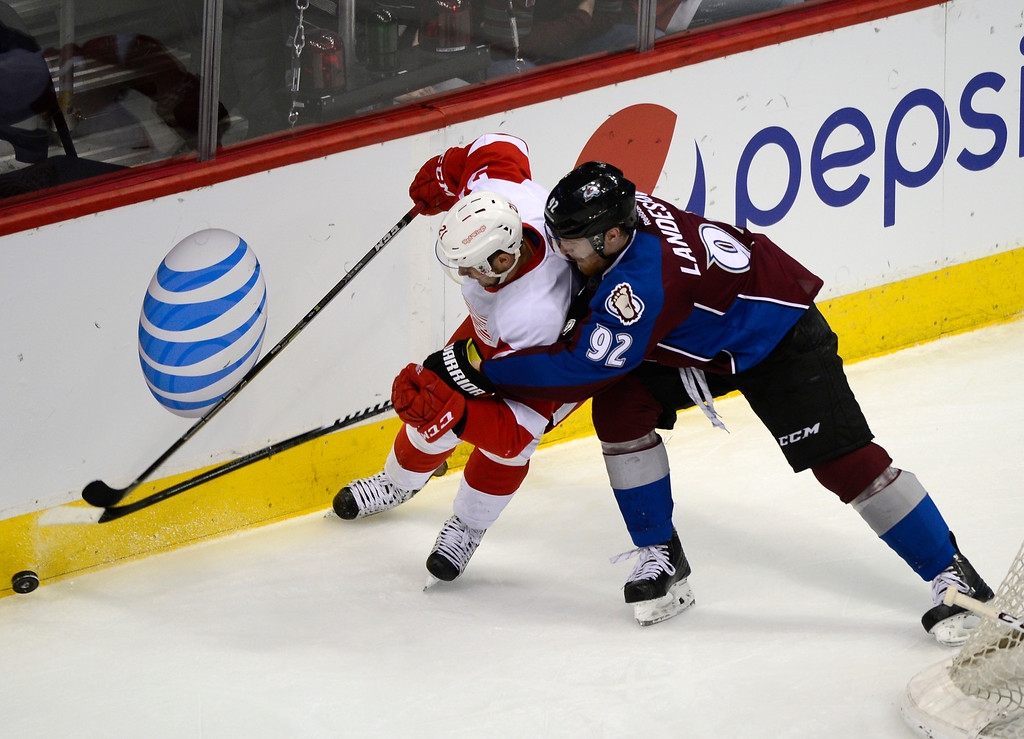 . DENVER, CO - February 5: Detroit Red Wings left wing Tomas Tatar (21) tries to keep possession of the puck from Colorado Avalanche left wing Gabriel Landeskog (92) during the second period Thursday, February 5, 2015 at the Pepsi Center in Denver, Colorado. (Photo By Brent Lewis/The Denver Post)