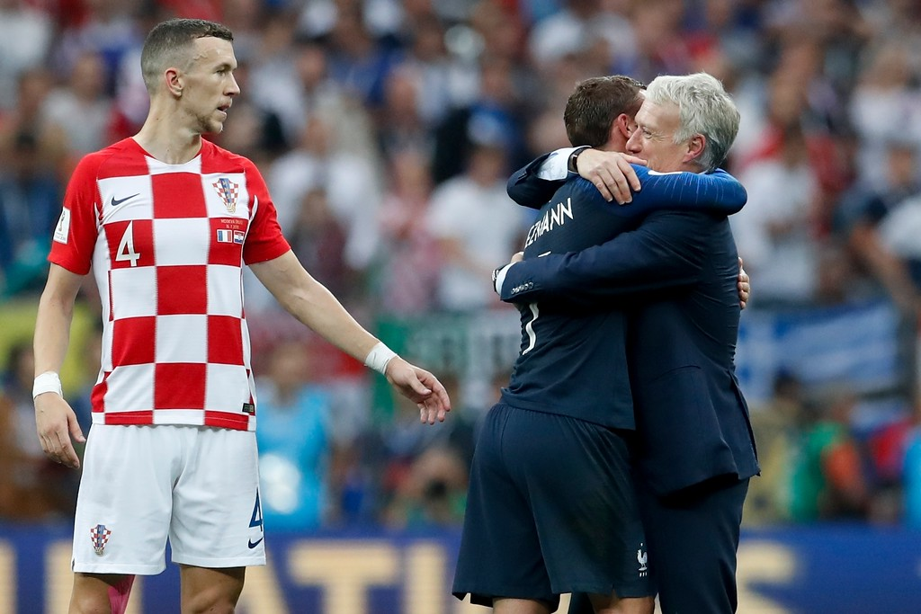 . France head coach Didier Deschamps, right, hugs Antoine Griezmann as Croatia\'s Ivan Perisic looks at them, at the end of the final match between France and Croatia at the 2018 soccer World Cup in the Luzhniki Stadium in Moscow, Russia, Sunday, July 15, 2018. France won 4-2. (AP Photo/Petr David Josek)