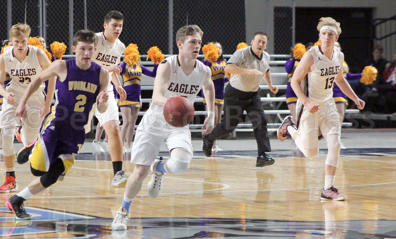Taylor Schildroth drives down the Cross Center court with from left, Max Mattson, Stefan Simmons and Beckett Slayton. Photo by Anne Berleant
