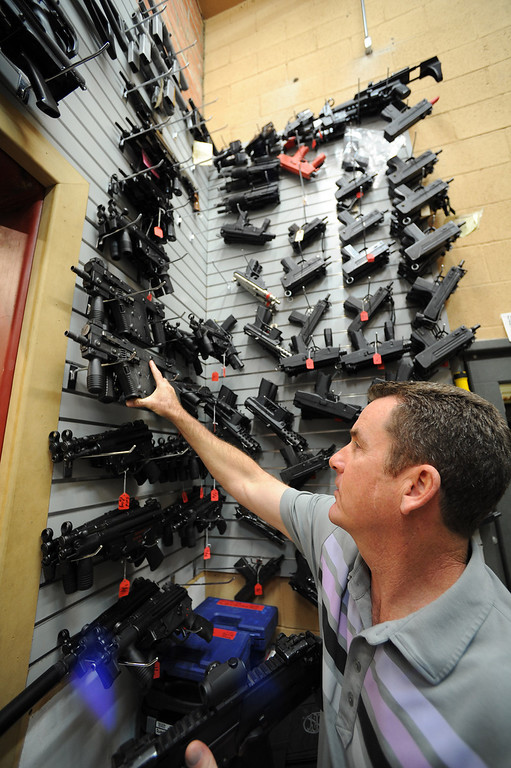 . Gregg Bilson, Jr.looks at studio prop assault weapons. Bilson is the CEO of ISS Independent Studio Services, a prop house that holds hundreds of thousands of items used for motion pictures and television production. Runaway production has an impact on his business. Sunland, CA 12-31-2013. photo by (John McCoy/Los Angeles Daily News)