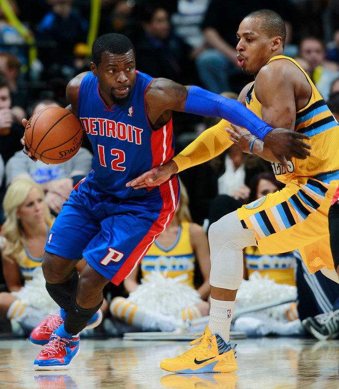 . Detroit Pistons guard Will Bynum, left, works ball inside as Denver Nuggets guard Randy Foye covers in the fourth quarter of the Nuggets\' 118-109 victory in an NBA basketball game in Denver on Wednesday, March 19, 2014. (AP Photo/David Zalubowski)