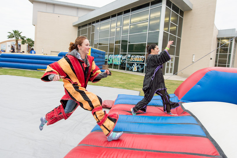 McKenzie Ward(left) Milaura Zepeda suit up to jump on the velcro wall during the 2016 Homecoming Friday Feista.