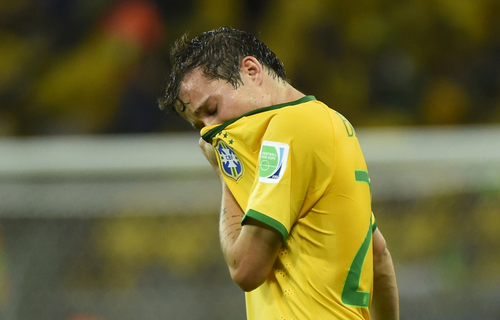 Description of . Brazil's forward Bernard reacts during the semi-final football match between Brazil and Germany at The Mineirao Stadium in Belo Horizonte during the 2014 FIFA World Cup on July 8, 2014. (FABRICE COFFRINI/AFP/Getty Images)