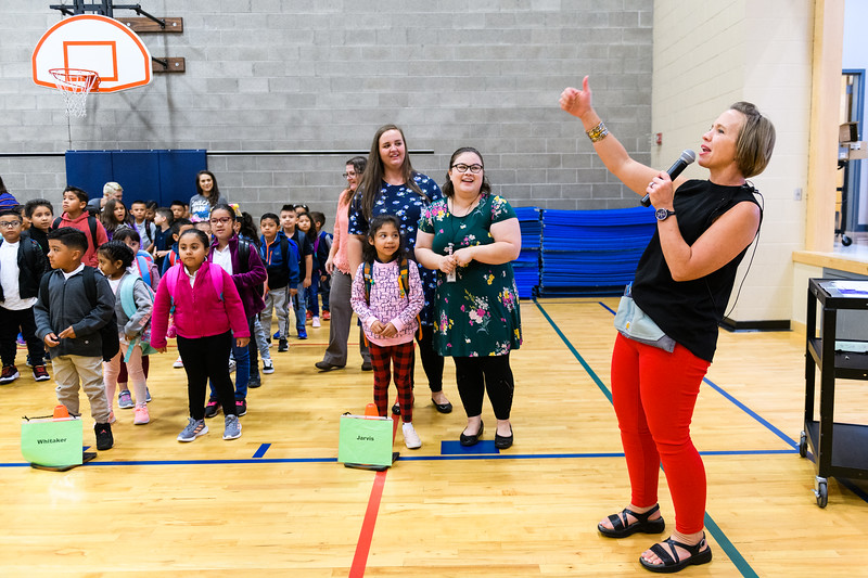 Hallman principal Jessica Brenden, right, leads the school in their daily affirmation exercise in the gymnasium. Back to school day at Hallman Elementary School on Wednesday, September 4, 2019 in Salem, Ore.