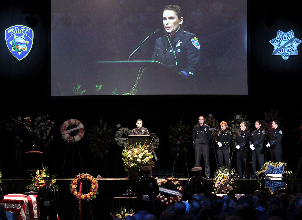 . With fellow female officers of her department at her side, Santa Cruz police officer Laurel Schonfield speaks about her friend and colleague detective Elizabeth Butler Thursday. (Shmuel Thaler/Sentinel)