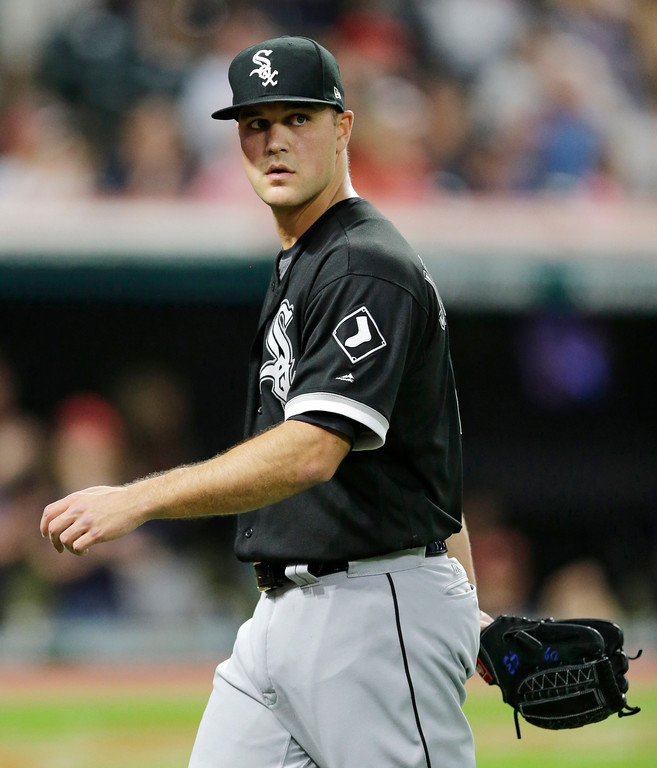 . Chicago White Sox relief pitcher Dan Jennings walks off the field in the sixth inning of a baseball game against the Cleveland Indians, Saturday, June 10, 2017, in Cleveland. (AP Photo/Tony Dejak)