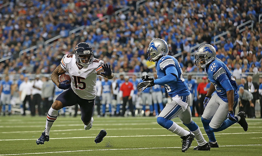 . Brandon Marshall #15 of the Chicago Bears runs for a first down during the fourth quarter of the game against the Detroit Lions at Ford Field on December 30, 2012 in Detroit, Michigan. The Bears defeted the Lions 26-24. (Photo by Leon Halip/Getty Images)