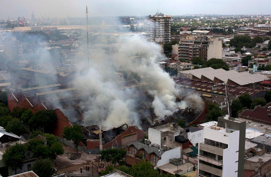 . Smoke rises from the Iron Mountain warehouse in Buenos Aires, Argentina, Wednesday, Feb. 5, 2014. (AP Photo/Rodrigo Abd)