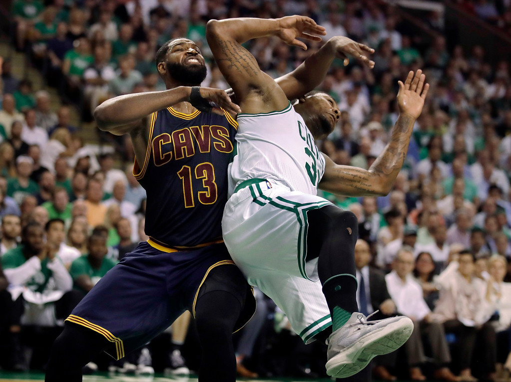 . Cleveland Cavaliers center Tristan Thompson (13) and Boston Celtics guard Marcus Smart tangle during the third quarter of Game 1 of the NBA basketball Eastern Conference finals, Wednesday, May 17, 2017, in Boston. (AP Photo/Charles Krupa)