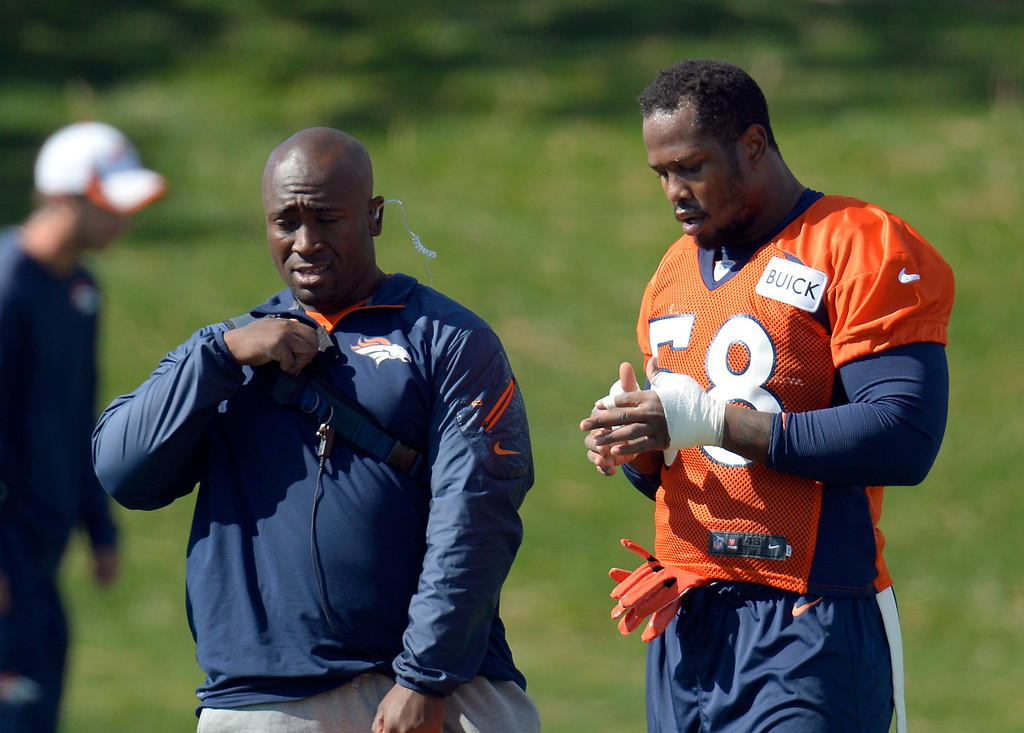 . Denver Broncos outside linebacker Von Miller (58) tapes up his fingers during his first day back to practice October 16, 2013 at Dove Valley. Miller just finished serving a six game suspension. (Photo by John Leyba/The Denver Post)