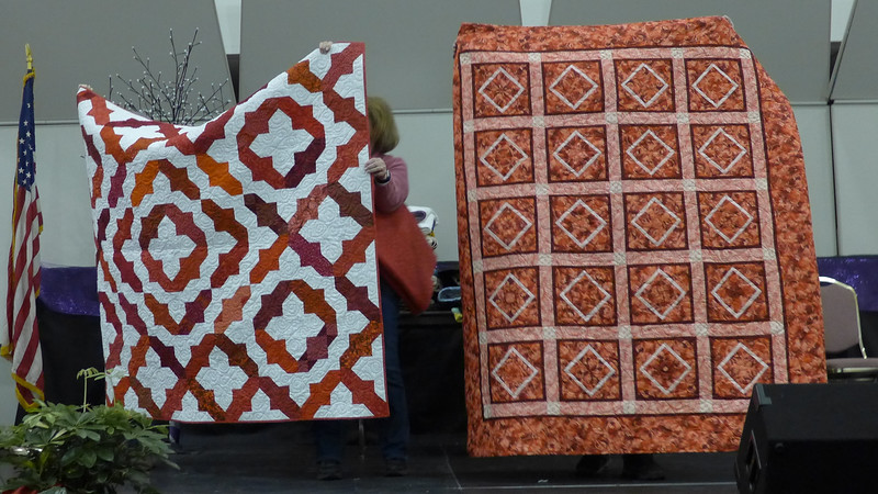 Jan Asmann said she was in her red period when she made these quilts.  The quilt on the left is for the Heart Warmers project and the other will be donated but recipient to be determined.