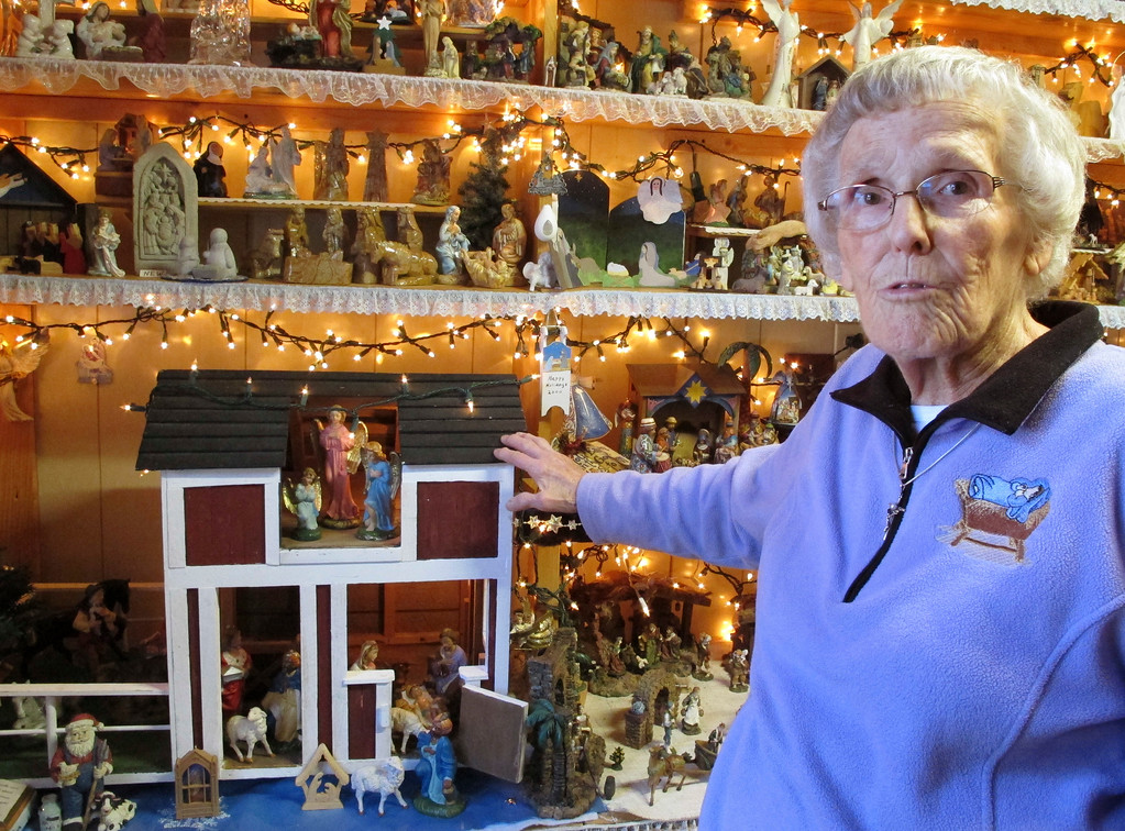 . In this Wednesday, Dec. 20, 2017 photo Shirley Squires, of Guilford, Vt., speaks with a reporter about her collection of more than 1,400 nativity scenes on display in her home. Each Christmas, she gets help putting up the miniature scenes and then opens her home to school groups and others for viewing. (AP Photo/Lisa Rathke)