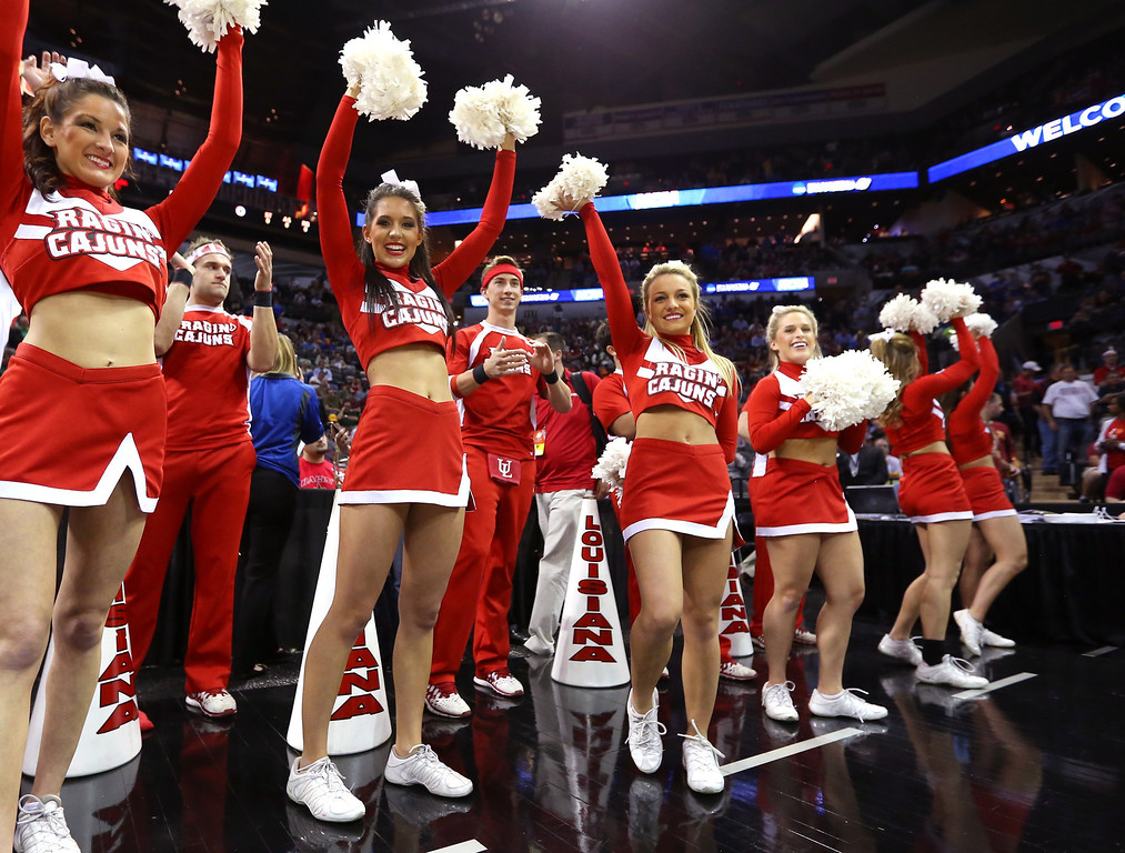 . The Louisiana Lafayette Ragin Cajuns cheerleaders perform in the first half against the Creighton Bluejays during the second round of the 2014 NCAA Men\'s Basketball Tournament at AT&T Center on March 21, 2014 in San Antonio, Texas.  (Photo by Ronald Martinez/Getty Images)