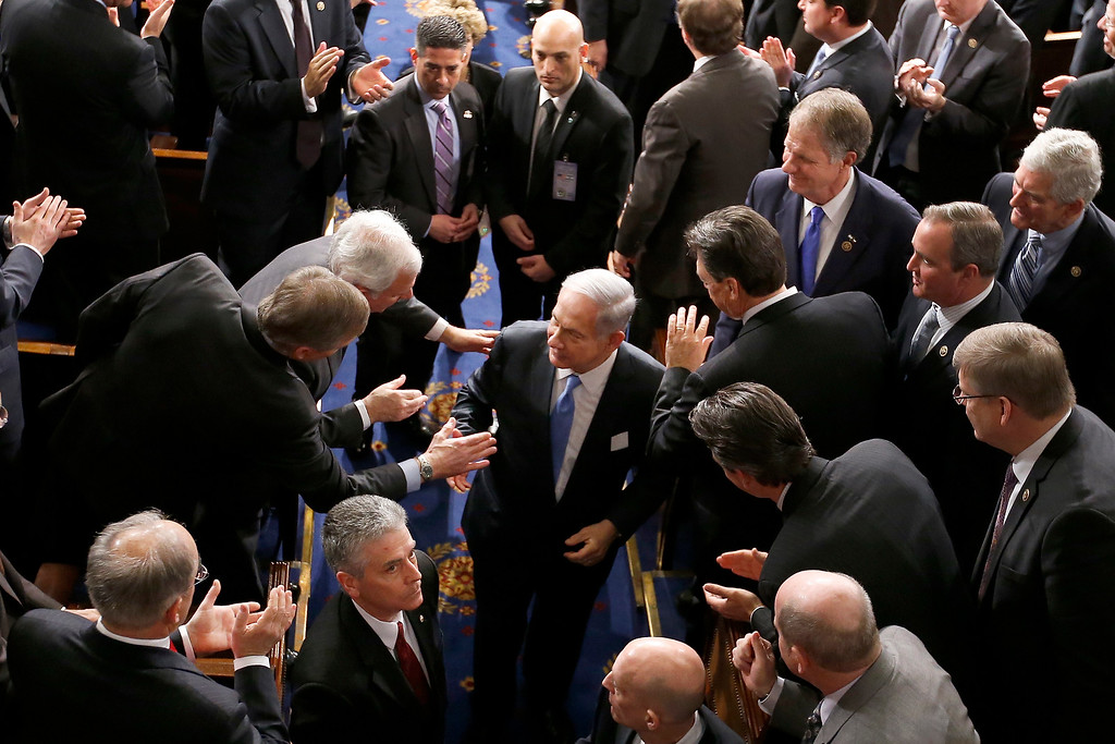 """. Israeli Prime Minister Benjamin Netanyahu shakes hands as he leaves the House chamber on Capitol Hill in Washington, Tuesday, March 3, 2015, after addressing a joint meeting of Congress. In a speech that stirred political intrigue in two countries, Netanyahu told Congress that negotiations underway between Iran and the U.S. would \""""all but guarantee\"""" that Tehran will get nuclear weapons, a step that the world must avoid at all costs. (AP Photo/Andrew Harnik)"""