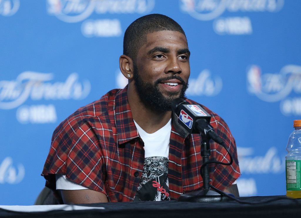 . Cleveland Cavaliers\' Kyrie Irving answers questions after Game 6 of the NBA basketball Finals against the Golden State Warriors, Friday, June 17, 2016, in Cleveland. The Cavaliers won 115-101. (AP Photo/Ron Schwane)
