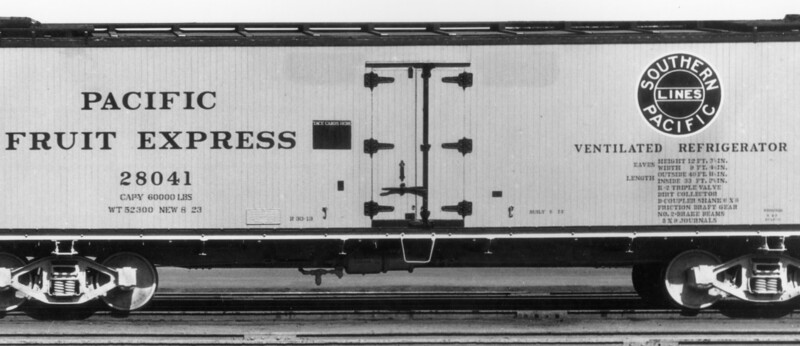 Built-up 30-ton underframe - R-30-13 version, KC brakes, left side . Piping between the trainline and the air reservoir passes under the center sills. Brake Reservoir/Cylinder is slightly left of center. B-end is to the right. PFE R-30-13 #28041 built 8-23 by PC&F. from Bob's Photo, probably PC&F builder's photo