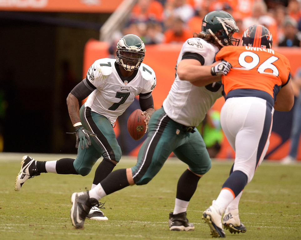 . Philadelphia Eagles quarterback Michael Vick (7) scrambles out of the pocket against the Denver Broncos defense during the third quarter September 29, 2013 at Sports Authority Field in Denver. (Photo by John Leyba/The Denver Post)