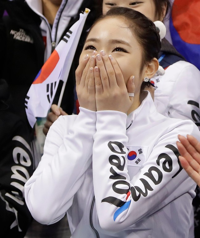 . Choi Dabin, of South Korea reacts to her scores after performing in the ladies single figure skating short program in the Gangneung Ice Arena at the 2018 Winter Olympics in Gangneung, South Korea, Sunday, Feb. 11, 2018. (AP Photo/Julie Jacobson)