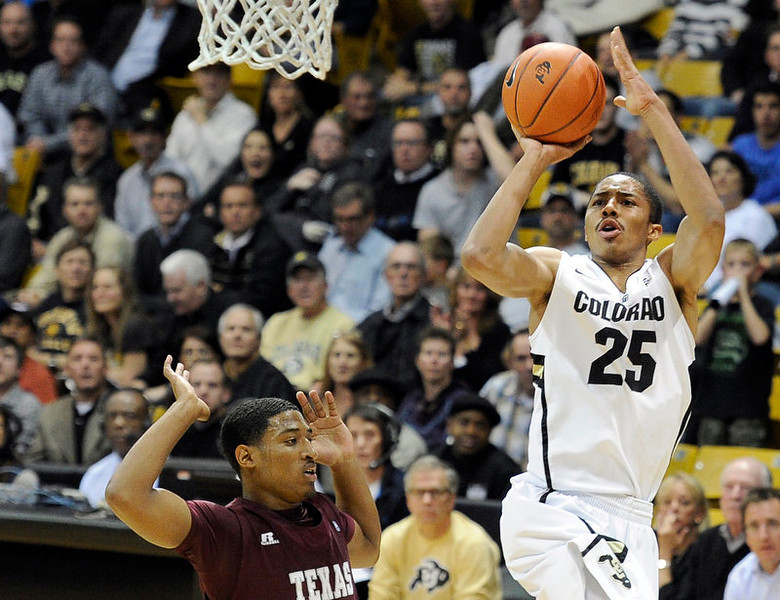 . University of Colorado\'s Spencer Dinwiddie takes a shot over Madarious Gibbs during a game against Texas Southern on Tuesday, Nov. 27, at the Coors Event Center on the CU campus in Boulder.  Jeremy Papasso/ Camera