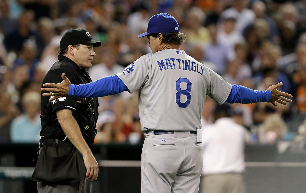 . Los Angeles Dodgers manager Don Mattingly (8) argues with home plate umpire Paul Schrieber against the Detroit Tigers in the sixth inning of a baseball game in Detroit, Tuesday, July 8, 2014. Mattingly was ejected from the game. (AP Photo/Paul Sancya)