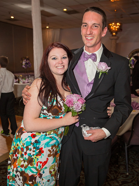 Bouquet and garter catch couple.jpg
