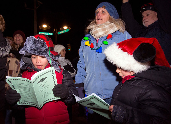12/03/19 Wesley Bunnell | Staff The 68th annual Bristol Carol Sing and 29th annual Tree Lighting presented by Webster Bank and the Central CT Chambers of Commerce took place on Tuesday night outside to Webster Bank at 150 Main St. Luke Hull, L age 8, and brother Matthew Hull, age 6, sign along.
