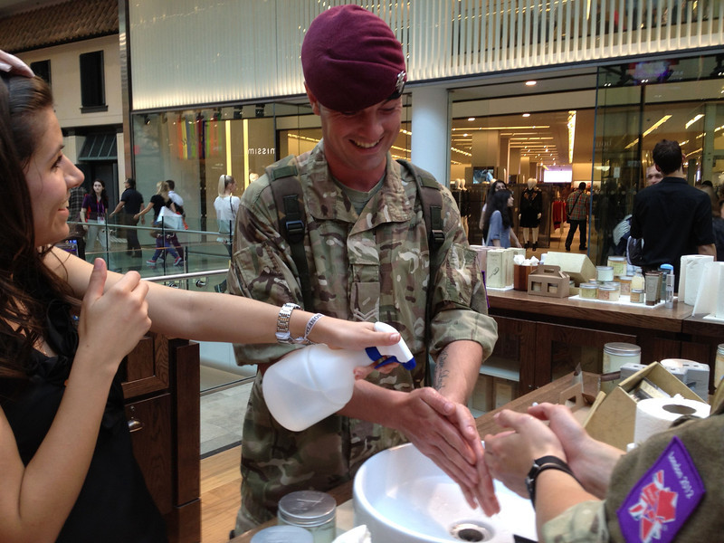 Service member's hand treatment at Westfield Mall