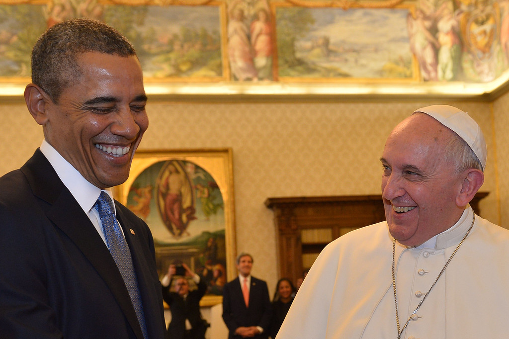 . Pope Francis (R) and US President Barack Obama laugh as they exchange gifts during a private audience on March 27, 2014 at the Vatican.   AFP PHOTO POOL / GABRIEL BOUYS/AFP/Getty Images