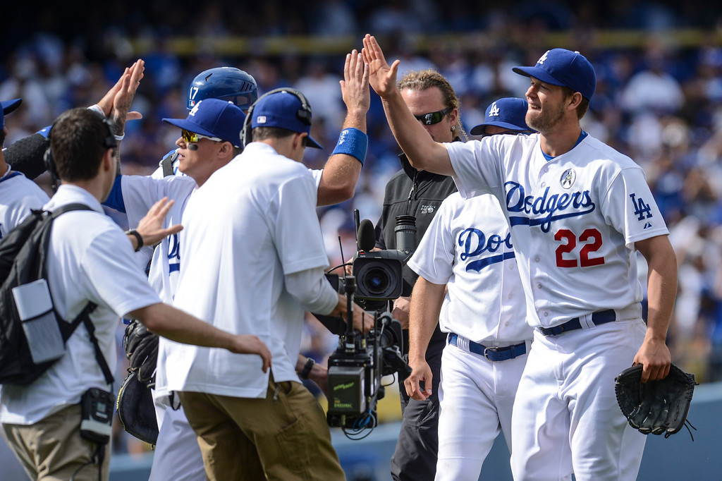 . Dodger\'s Clayton Kershaw is congratulated by teammates after defeating the Giants 4-0.  Photo by David Crane/Los Angeles Daily News.