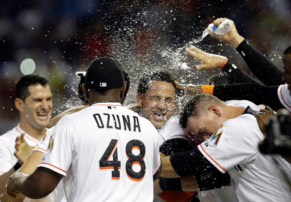 . Miami Marlins\' Henderson Alvarez, center, celebrates with teammates after pitching a no-hitter against the Detroit Tigers after an interleague  baseball game, Sunday, Sept. 29, 2013, in Miami. The Marlins won 1-0. (AP Photo/Alan Diaz)