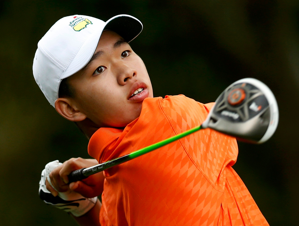 Description of . Amateur Guan Tianlang of China hits his tee shot on the second hole during second round play in the 2013 Masters golf tournament at the Augusta National Golf Club in Augusta, Georgia, April 12, 2013.   REUTERS/Mark Blinch