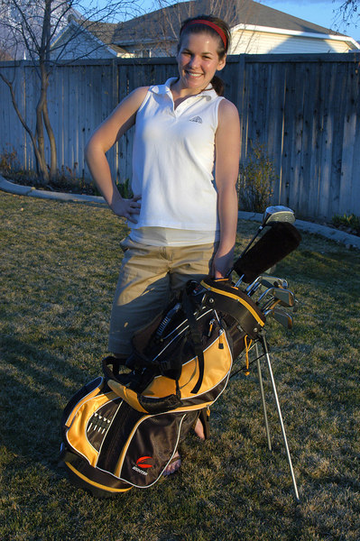 3/24/07 – Jessica and I played nine holes late this afternoon. But before we played we went and got her a new golf bag. It is an early birthday gift since she will be in Hawaii for her 20th birthday. It is a carry bag with the double shoulder straps. It slips over her shoulders like a backpack. She carried her clubs for the full nine holes. She says her backpack she carries every day at school is much heavier.
