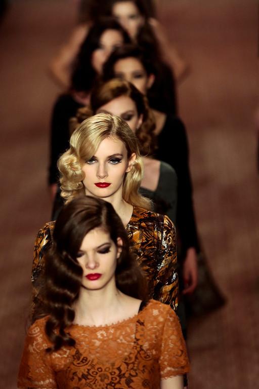 . Models wear creations  of  Lena Hoschek\'s Autumn Winter 2014 collection during the Mercedes Benz Fashion Week in Berlin, Tuesday, Jan. 14, 2014. (AP Photo/Markus Schreiber)