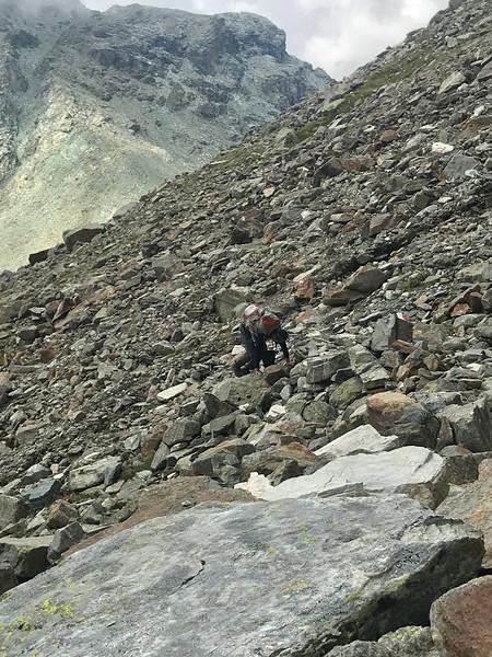 Harvey picking his way across the rockfall
